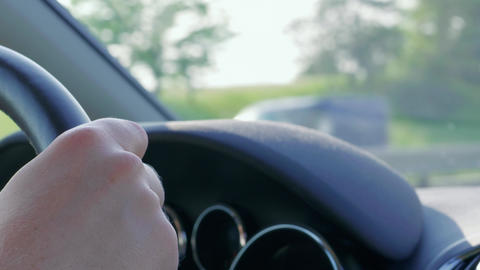 Hand on car steering wheel at automobile driving on highway Live Action