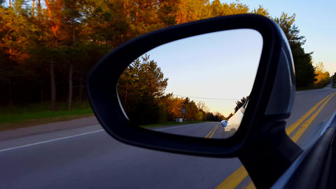 Driving Rural Road View of Side Mirror at Sunset. Driver... Stock Video Footage