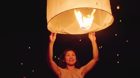 Asian Woman Releasing A Sky Lantern Live Action