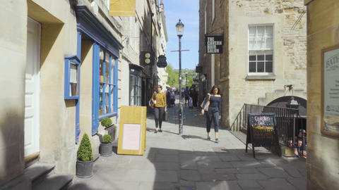 Bath, United Kingdom - May 13, 2019: POV walking downtown streets of Bath city Live Action