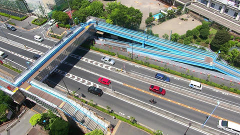 An eyelid view. Vehicles coming and going with footbridge Footage