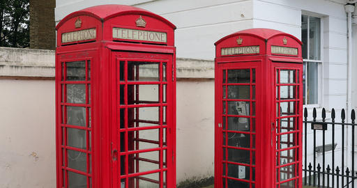 Two Red British Telephone Boxes Live Action