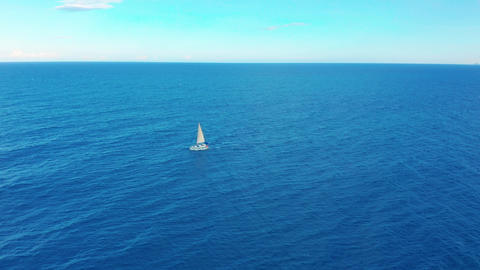 Yacht sailing on opened sea. Sailing boat. Yacht seen from drone. Yachting Footage