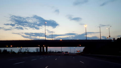 Driving Dim Morning Highway With Sunrise on Horizon.... Stock Video Footage