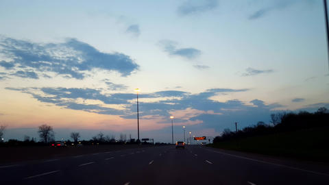 Driving Dim Morning Highway With Sunrise on Horizon. Driver Point of View POV Interstate Driving Live Action