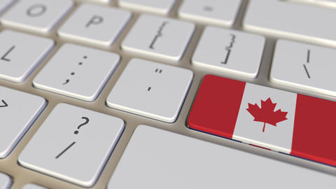 Key with flag of Canada on the computer keyboard switches to key with flag of Footage