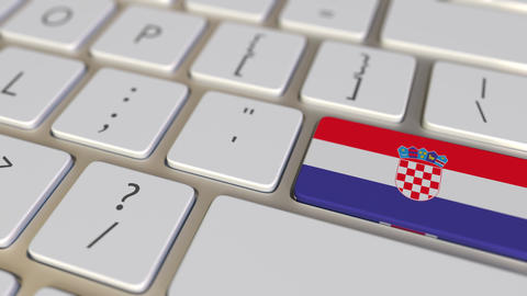 Key with flag of Croatia on the computer keyboard switches to key with flag of Footage