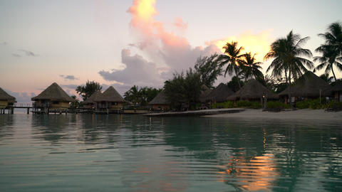 Travel vacation paradise with overwater bungalow resort hotel in coral reef sea Live Action