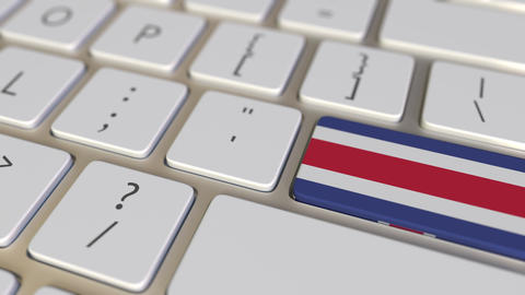 Key with flag of Costa Rica on the computer keyboard switches to key with flag Footage