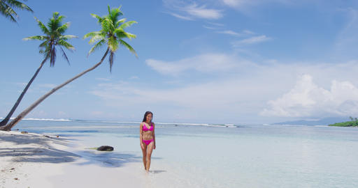 Beach vacation paradise suntan woman relaxing lying down sun tanning in tropics Footage