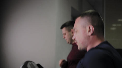 Two Man are running on treadmill in sports club. Sport... Stock Video Footage