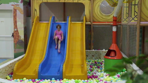 A girl riding with children's slides Footage