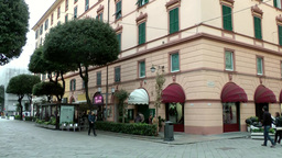 Europe Italy Liguria Savona 033 pastel colored hotel building in city center Footage