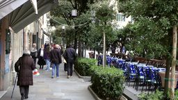 Europe Italy Liguria Savona 036 footpath with people and street café Footage