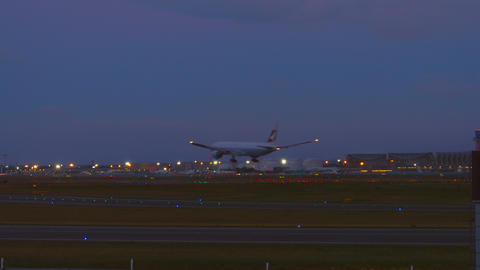 Cathay Pacific Boeing 777 landing at early morning Footage