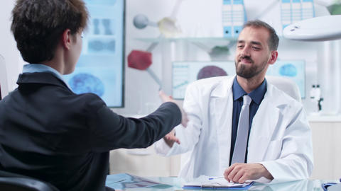 Physician having a converstation with a patient in a modern office Live Action