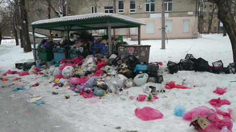 Overfilled garbage bins with rubbish bags Live Action