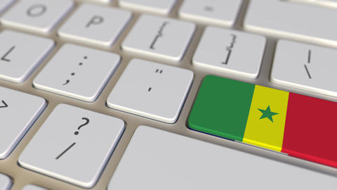 Key with flag of Senegal on the computer keyboard switches to key with flag of Live Action
