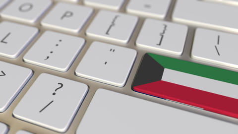 Key with flag of Kuwait on the computer keyboard switches to key with flag of Footage