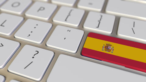 Key with flag of Spain on the computer keyboard switches to key with flag of Footage