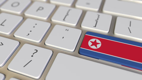 Key with flag of North Korea on the computer keyboard switches to key with flag Footage