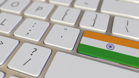 Key with flag of India on the computer keyboard switches to key with flag of Footage