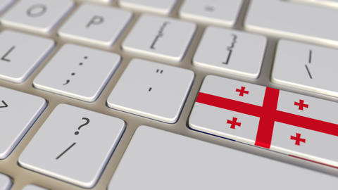 Key with flag of Georgia on the computer keyboard switches to key with flag of Live Action