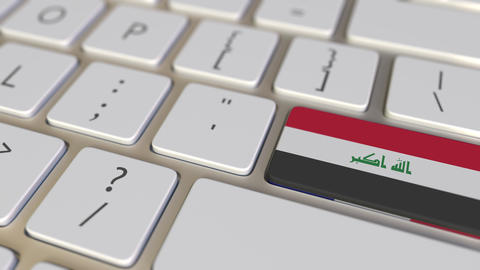 Key with flag of Iraq on the computer keyboard switches to key with flag of Live Action