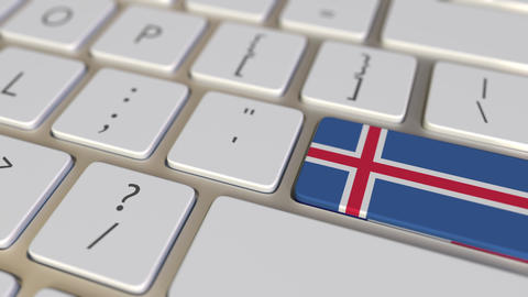 Key with flag of Iceland on the computer keyboard switches to key with flag of Footage