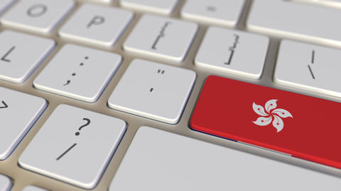 Key with flag of Hong Kong on the computer keyboard switches to key with flag of Footage
