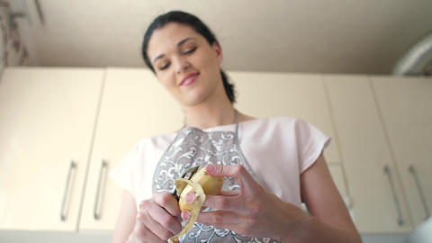 Woman peels potatoes at kitchen Live Action