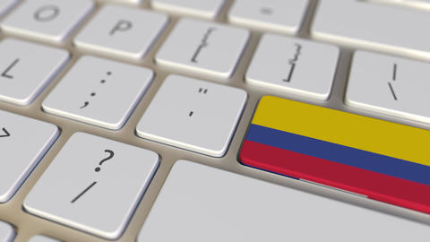 Key with flag of Colombia on the computer keyboard switches to key with flag of Live Action