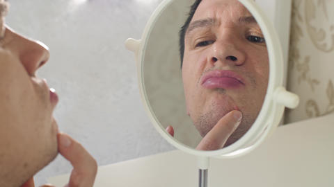 Man with pimples in a front of mirror Footage