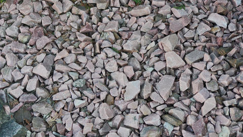 Crushed stone. crushed stone of two colors. gravel. Close-up Footage