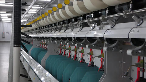 spools of thread at a textile factory Live Action