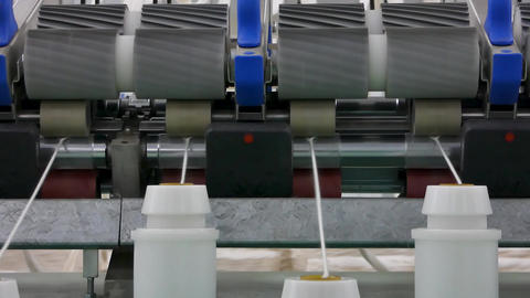 production of threads in a textile factory Live Action
