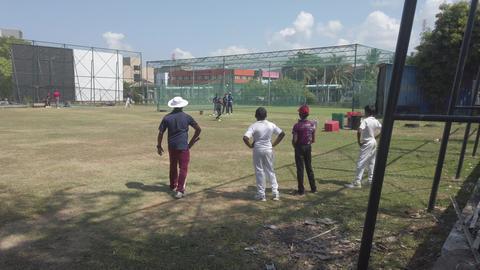 Galle, Sri Lanka - 2019-04-01 - Teenage Cricket Practice - Coach Hits For Footage