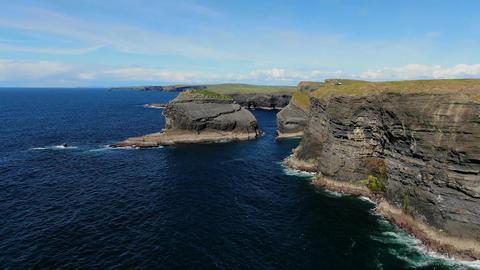 Deep blue Atlantic ocean water at the Cliffs of Kilkee in Ireland Footage