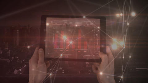 Man using a tablet computer with light connections animated on the foreground Animation