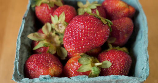 Close up of fresh organic seasonal spring strawberries in a paper carton straight from the farmers Footage