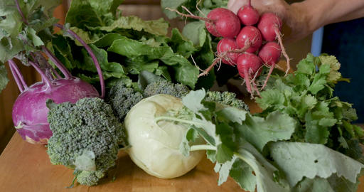 Hand picking up a variety of fresh organic produce and vegetables from a farmers market including Footage