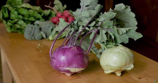 Hand touching a ripe, seasonal, organic purple kohlrabi... Stock Video Footage