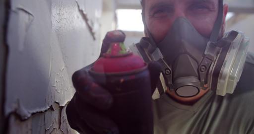 Graffiti artist spraying spray paint at camera 4k Live Action