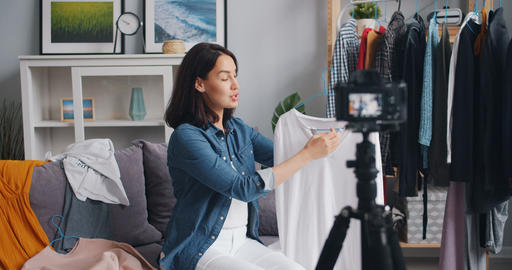 Female stylist recording video about modern clothes for interner vlog at home Footage