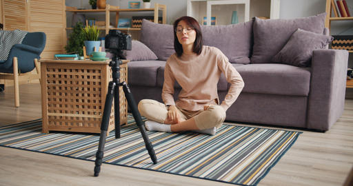 Emotional young woman vlogger recording video for internet vlog at home Footage