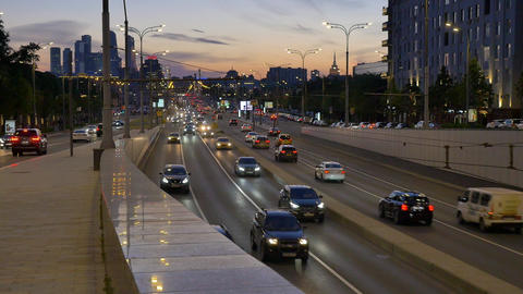 cars drive along street to tunnel traffic interchange Live影片