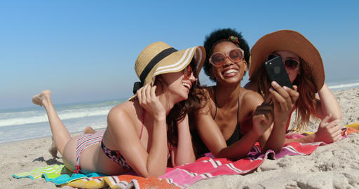 Young female friends having fun at beach 4k Live Action