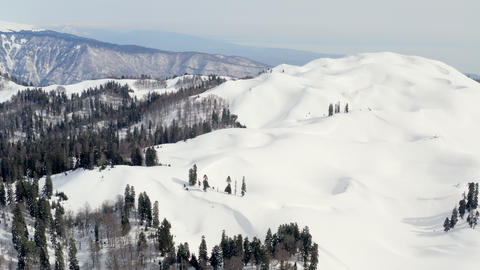 Aerial landscape snowy mountain and winter forest. Drone view from above winter mountains with snowy Footage