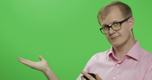 Caucasian man scrolling, texting on the smartphone. Place for your logo or text Footage