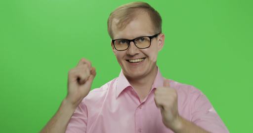 Caucasian man in pink shirt show thumbs up. Chroma key Footage